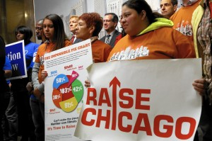 Aldermen Bob Fioretti, 2nd, John Arena, 45th and Nicholas Sposato, 36th stand in back along with members of Action Now and the Raise Chicago Coalition at a press conference at City Hall in Chicago Monday Dec. 1, 2014 to advocate for a $15 minimum wage in Chicago.  (Nancy Stone/Chicago Tribune)