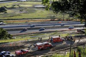 Emergency workers respond to the site where a 28-year-old construction worker died after he was crushed by rolling pipe at a road project southwest of the Petaluma Boulevard South exit off Highway 101 in Petaluma on Wednesday, April 15, 2015. (BETH SCHLANKER/ PD)